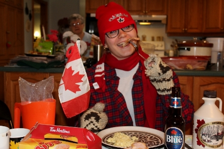 Oh Canadian, a girl sits at a table with all things typically Canadian